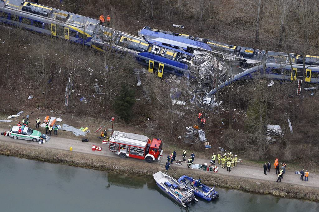 Aerial view of rescue workers at the site where two trains collided head-on near Bad Aibling, Germany, Tuesday, Feb. 9, 2016. Several people have been killed and dozens were injured. (AP Photo/Matthias Schrader)